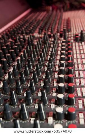 Mixing desk in recording studio.