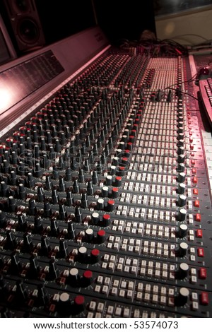 Mixing desk in recording studio.