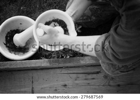 mixing grinding spices in a mortar #279687569