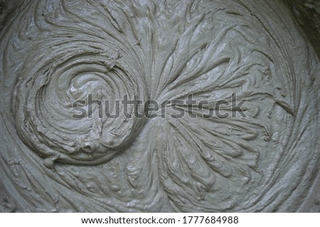 Mixing of dry building mixes with mixers. Wet mortar mixture for finishing work in construction. Traces of rotation of the tool, prints on cement. Close-up Foto stock ©