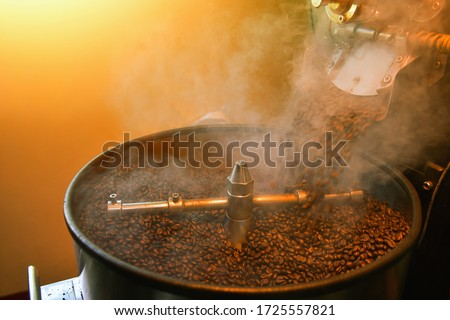 Mixing roasted coffee.Roasting Plant. Fresh Roasted Coffee. Stainless drum. Industrial electric cooling tray.
