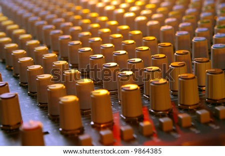 mixing soundboard under multi-colored lights