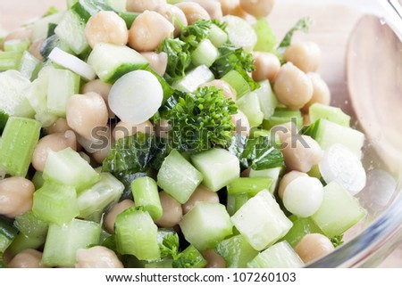 Mixture of chickpeas parsley, green onions, chopped celery and chopped cucumbers.