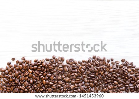 Mixture of different kinds of coffee beans. Coffee Background. roasted coffee beans. coffee beans on structural white wooden background.