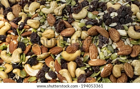 Mixture of nuts and dried fruit at local farm market.