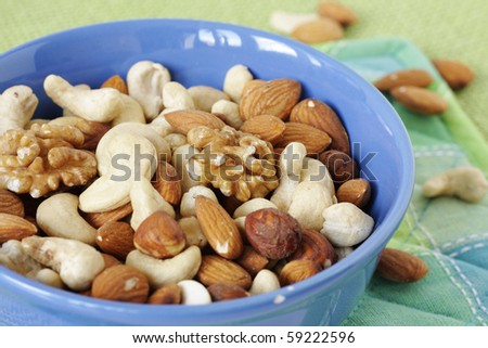 Mixture of nuts in blue bowl