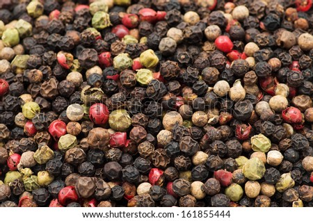 mixture of peppers hot pepper, red pepper, black pepper, white pepper, green pepper, background