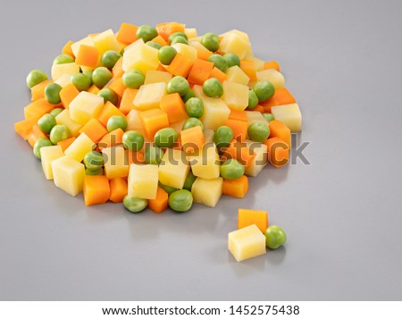 Mixture vegetables ,potato and carrot with green pea on gray background. Stok fotoğraf ©