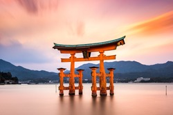Miyajima, Hiroshima, Japan at the floating gate of Itsukushima Shrine. (gate sign reads Itsukushima Shrine)