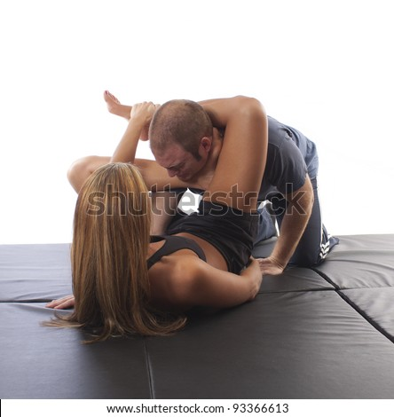 MMA female fighter demonstrating a Jiu-Jitsu ankle choke