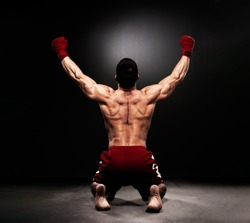 MMA Fighter On the Floor Celebrating Victory