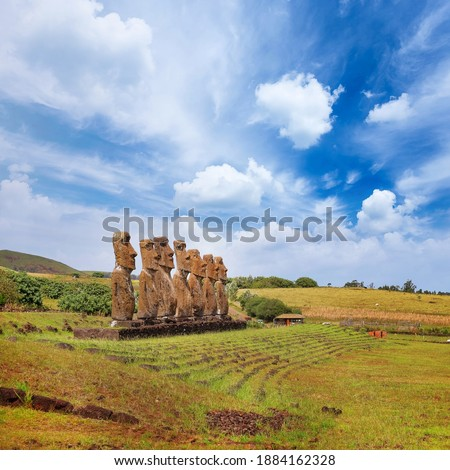 Moai statues at the Ahu Akivi Ceremonial complex on Easter Island, against a blue sky. Stok fotoğraf ©