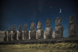 Moais at Ahu Tongariki (Easter island, Chile). night shining moon and stars