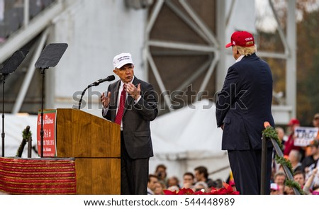 Mobile, Alabama - 12/17/2016:  Alabama Senator and incoming US Attorney General Jeff Sessions speaks to the crowd with US President-elect Donald J. Trump at Ladd-Peebles Stadium.