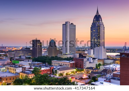 Mobile, Alabama, USA downtown skyline at dusk.