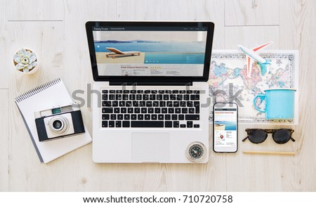 Mobile and laptop with travel agency responsive web. All graphics are made up. - Shutterstock ID 710720758