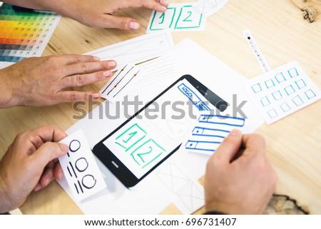Mobile app design concept hands #696731407