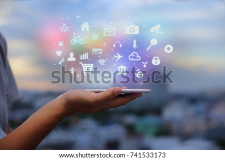 Mobile application concept.Man using touch screen smart phone on blurred urban city background