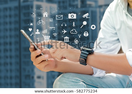 mobile apps concept.Business man hands holding touch screen smartphone ,application #582775234