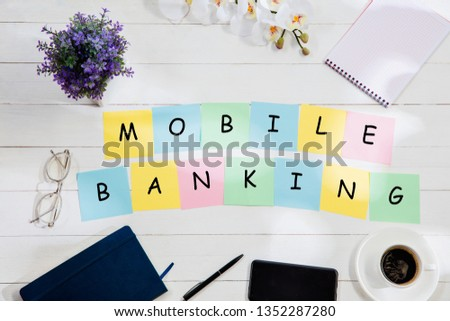 MOBILE BANKING. Message at colorful note papers on a desk background. Lifestyle, business, office, finance, plan, success, bank and management concept. Top or flat lay view. #1352287280
