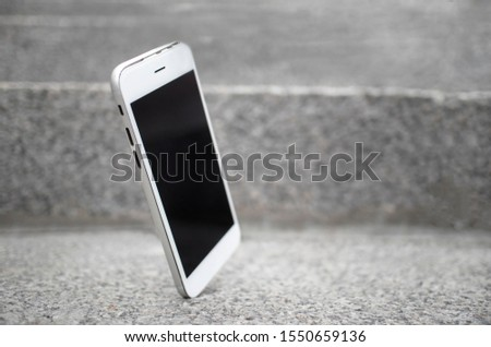 Mobile cell phone falls from hands and crashes on stairs, on asphalt. Broken smartphone falling to the floor, gadget, device needs to repair. Accident with telephone.