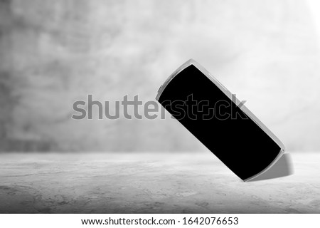 Mobile cell phone with blank screen on desk