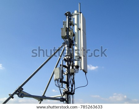 Mobile cellular telecommunication antenna network with blue sky scene #785263633