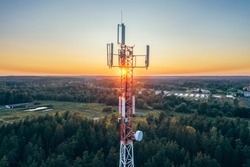 Mobile communication tower during sunset from above. (high ISO image)