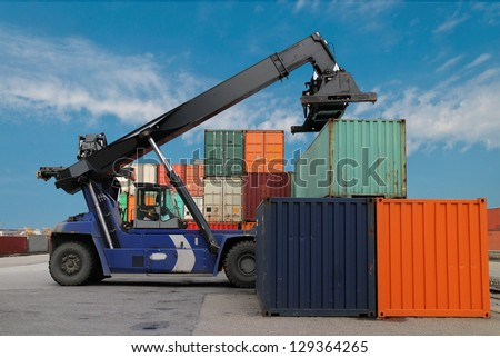 Mobile crane and cargo container on a transport site