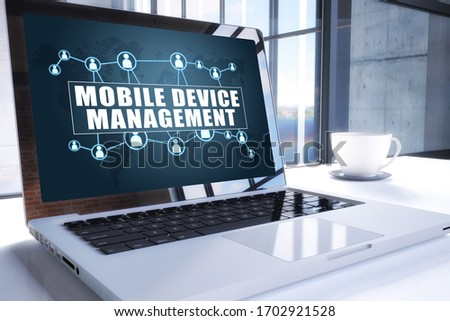 Mobile Device Management text on modern laptop screen in office environment. 3D render illustration business text concept. stock photo
