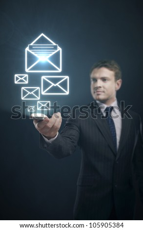 Mobile email in hand of businessman