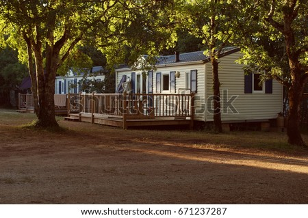 Mobile home in a French forest at Sunset