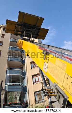 Mobile moving vehicle with lift carrying furniture up and down. - stock photo