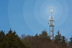 Mobile network radio mast in front of blue sky