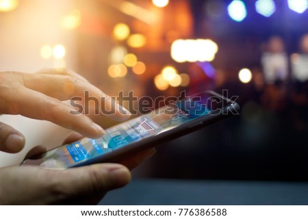 Mobile payment, Man using mobile payments online shopping and icon on night background, All on screen and credit card are design up. #776386588