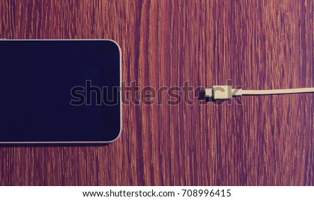 Mobile phone and charger #708996415