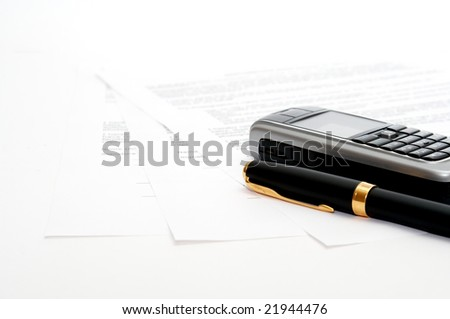mobile phone and ink pen on the documents