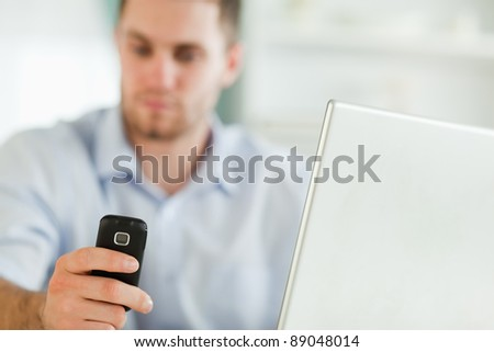 Mobile phone being used by young businessman