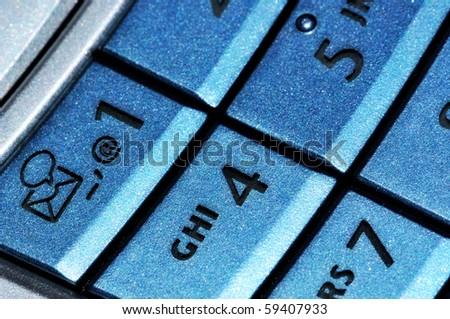 Mobile phone blue keyboard macro close view background