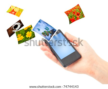 Mobile phone in hand. Isolated on white.