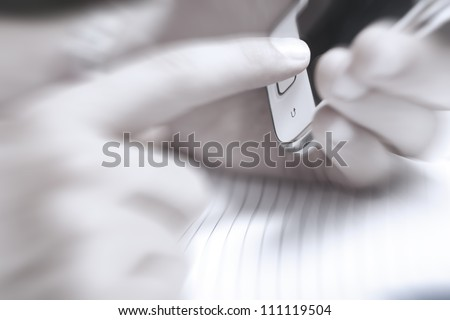 Mobile phone in hand of businessman