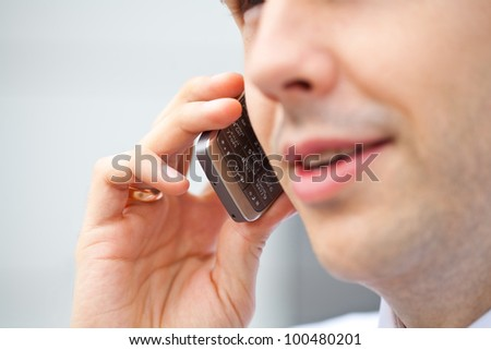 Mobile phone in man's hand - stock photo