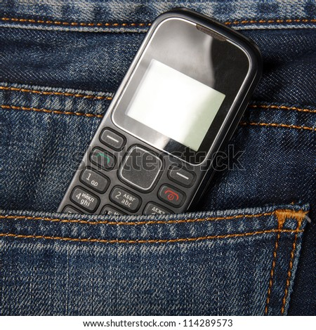 Mobile phone in pocket jeans