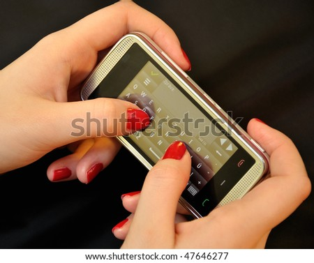 Mobile phone in the hands of women