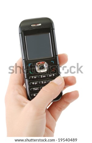 Mobile phone in woman hand - stock photo