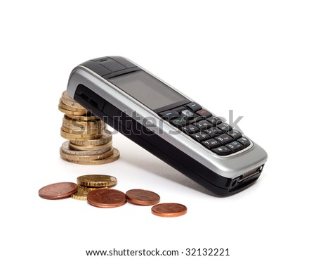 mobile phone laying on column of coins with several euro cents in front over white - stock photo