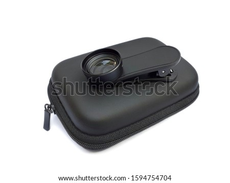 Mobile phone macro lens with holding clip and case isolated on white background. 20x macro lens for smartphone.