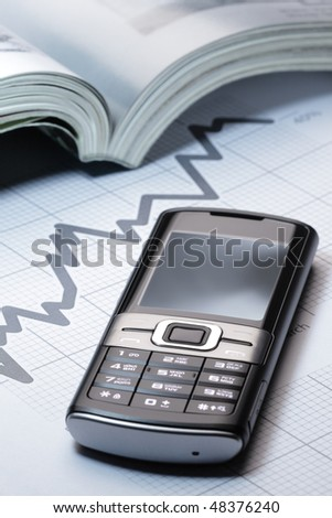 Mobile phone on business background