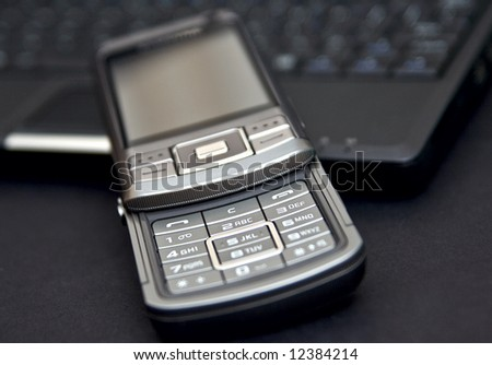 mobile phone on laptop