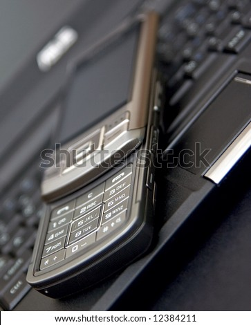 mobile phone on notebook